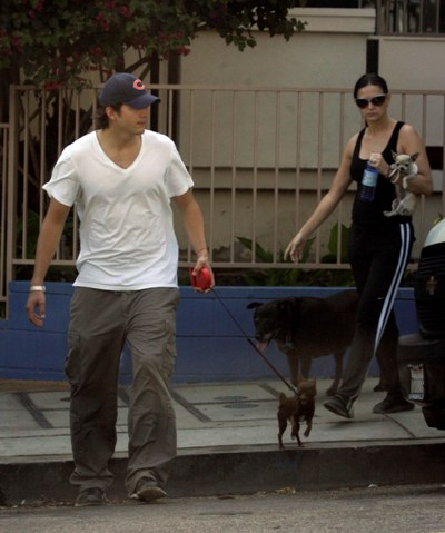 Demi Moore and Ashton Kutcher with dogs