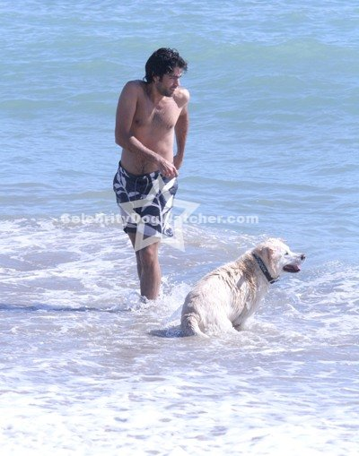Adrian Grenier on the beach with dog